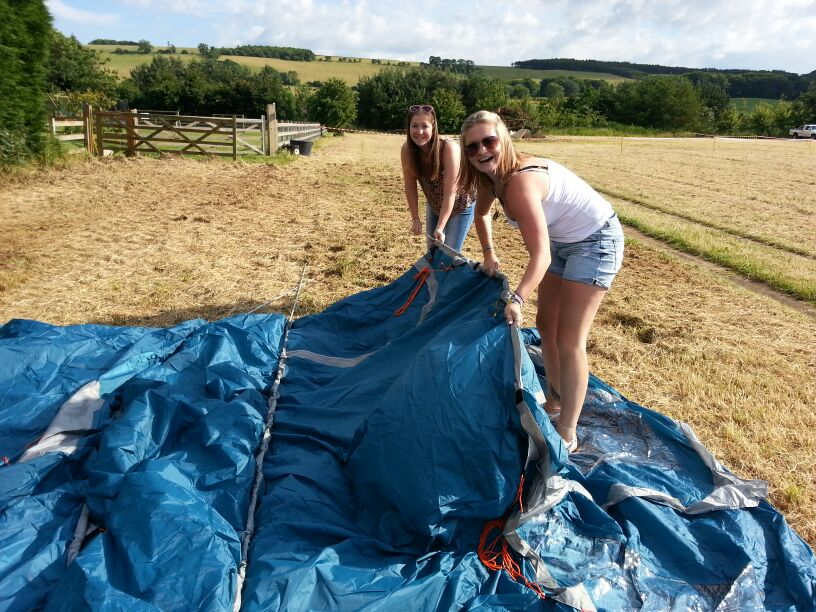 tent-field-camping-dancing-in-a-field